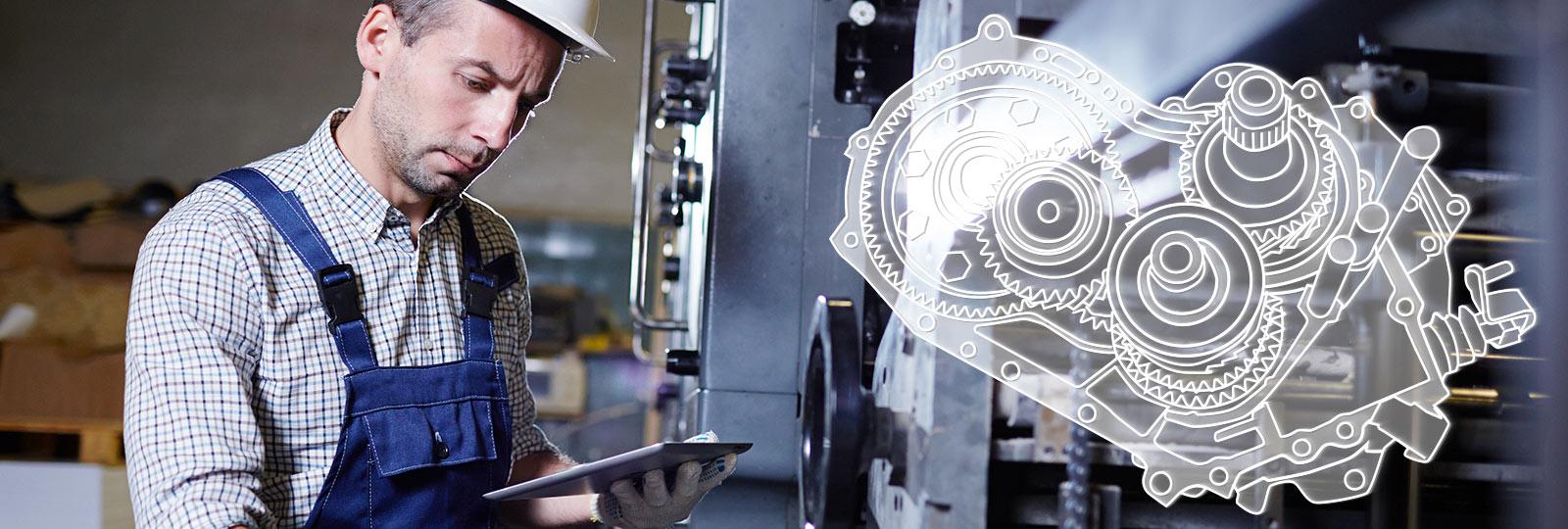 Mitarbeiter bei der Betrachtung von Maschinenbauteilen mit komplexer Geometrie